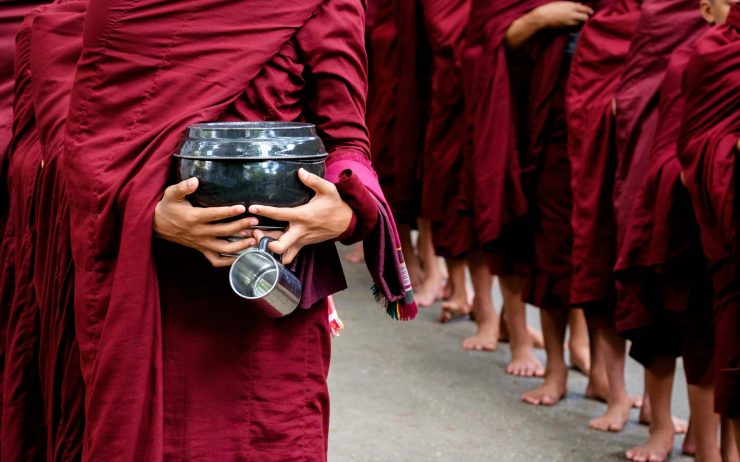 detail-of-buddhist-monks-crowd-and-person-holding-PKCY67V.jpg